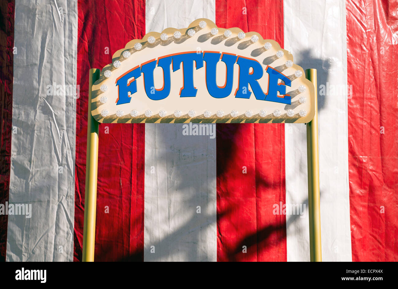 Future sign sign against red and white circus tents - Stock Image