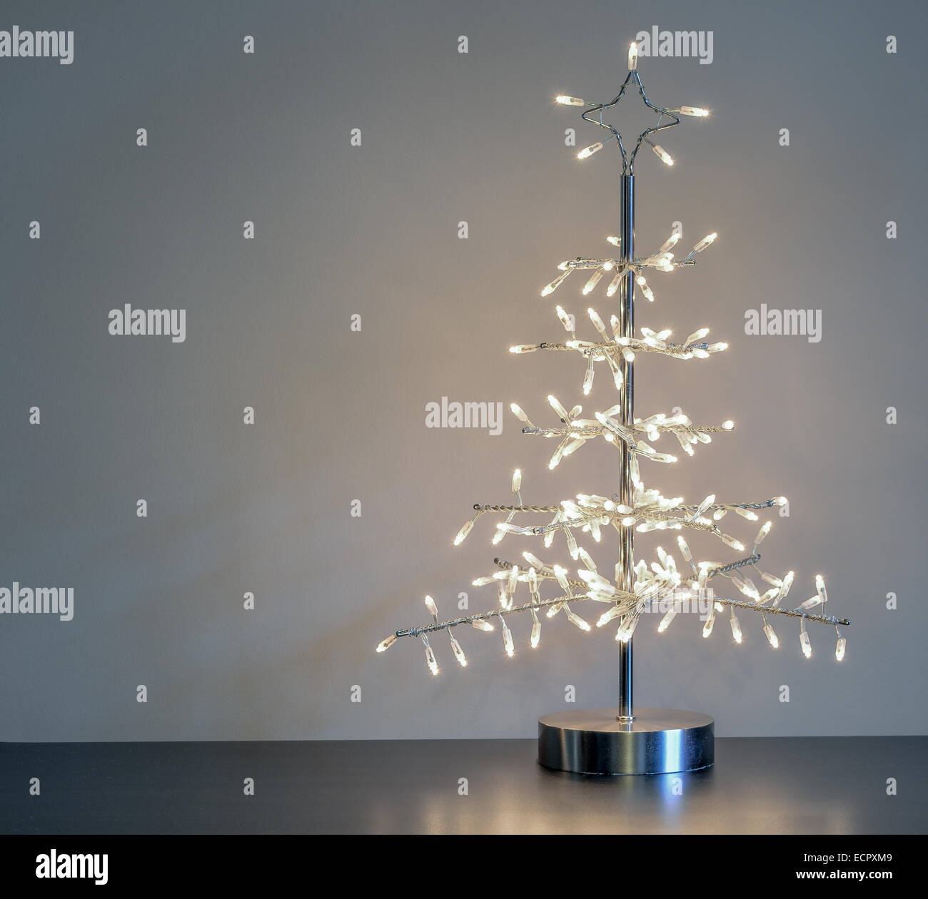 Silver Metal Minimalist Christmas Tree Ornament With White Lights Stock Photo Alamy