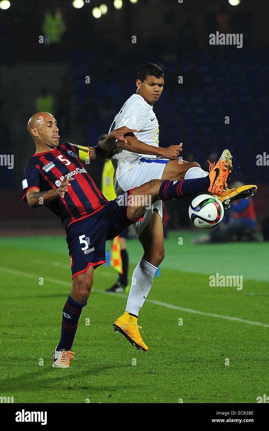 Marrakech, Morocco. 17th Dec, 2014. S. Lorenzo defender JUAN MERCIER (L) trips up with Auckland City forward RYAN - Stock Image
