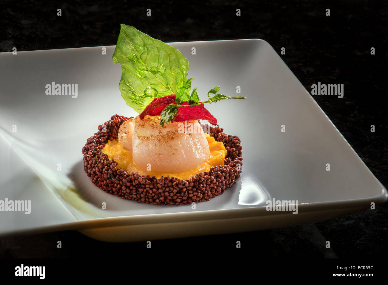 Scallop pumpkin puree fried basil beetroot thyme Quinoa Amuse-Bouche fine food - Stock Image