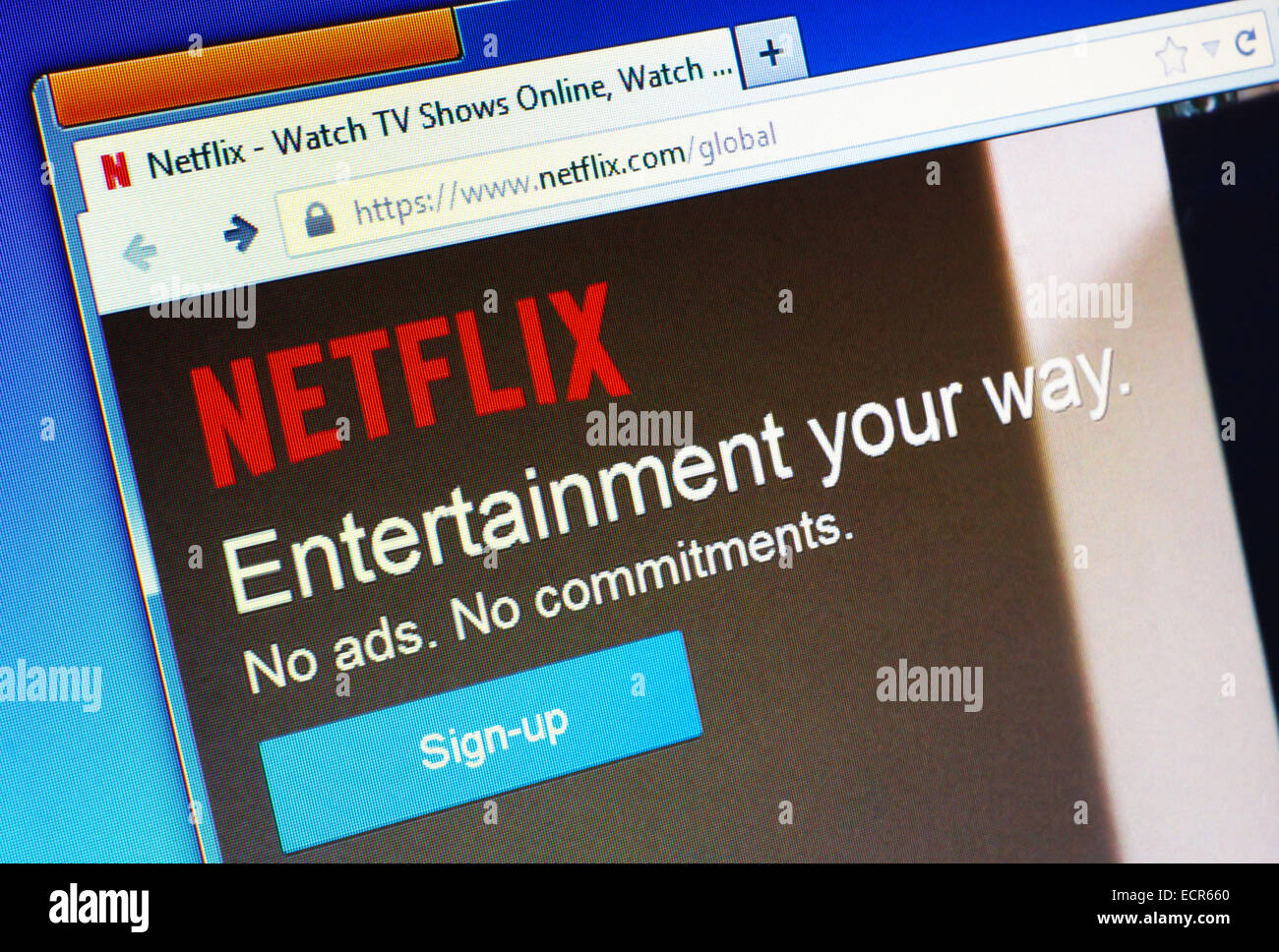 Netflix.com homepage on the computer screen. Netflix is a provider on-demand streaming media. Editorial use only - Stock Image