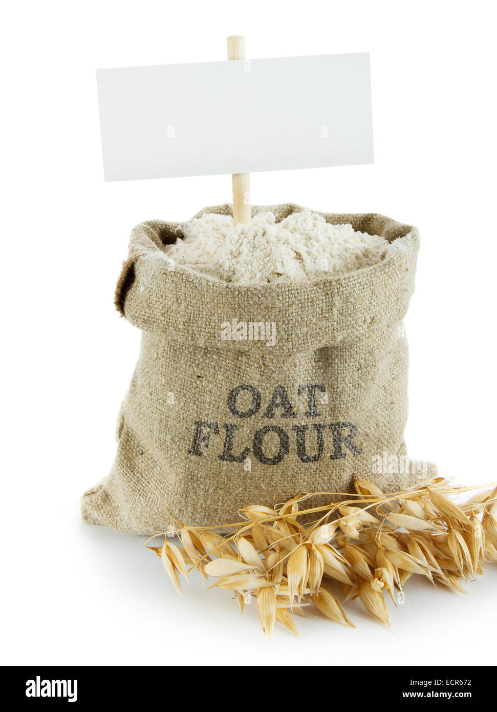 Oat flour in small linen sack. Empty space for your text - Stock Image