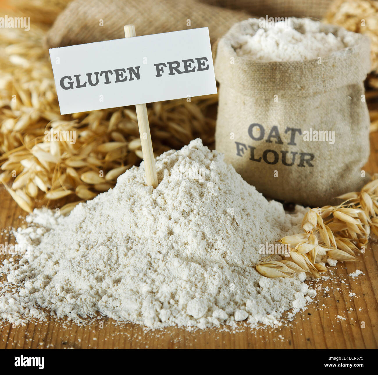 Oat flour on wooden table - Stock Image