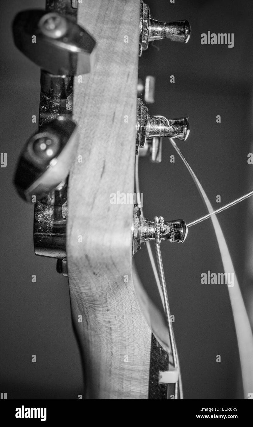 Guitar neck/ head with tuning pegs while tuning and string with motion blur. - Stock Image