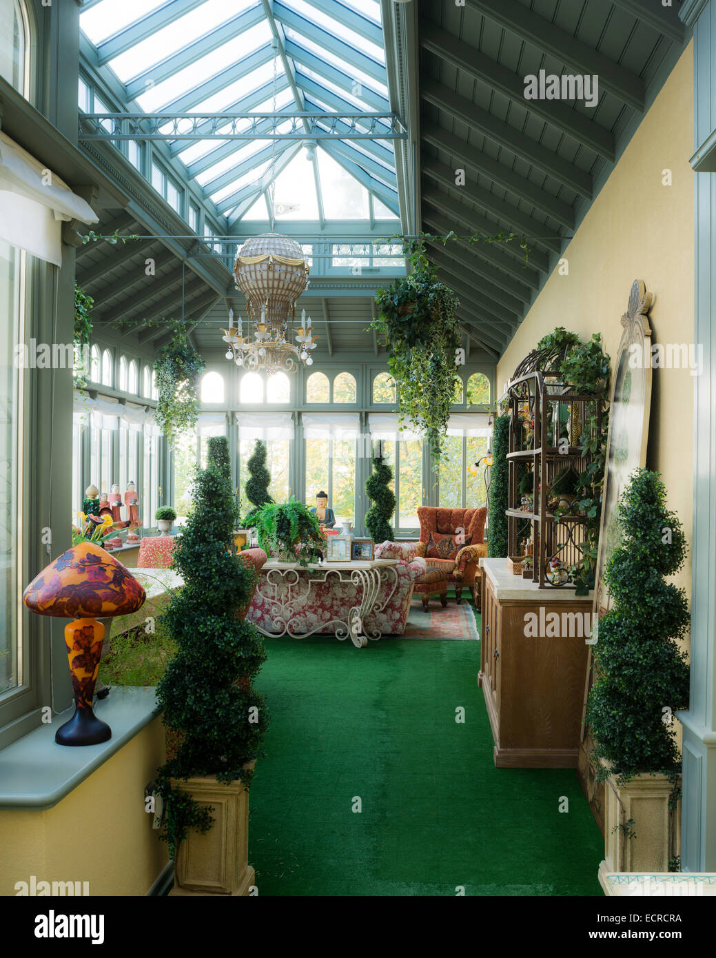 Green carpets and box hedge topiary in orangerie - Stock Image