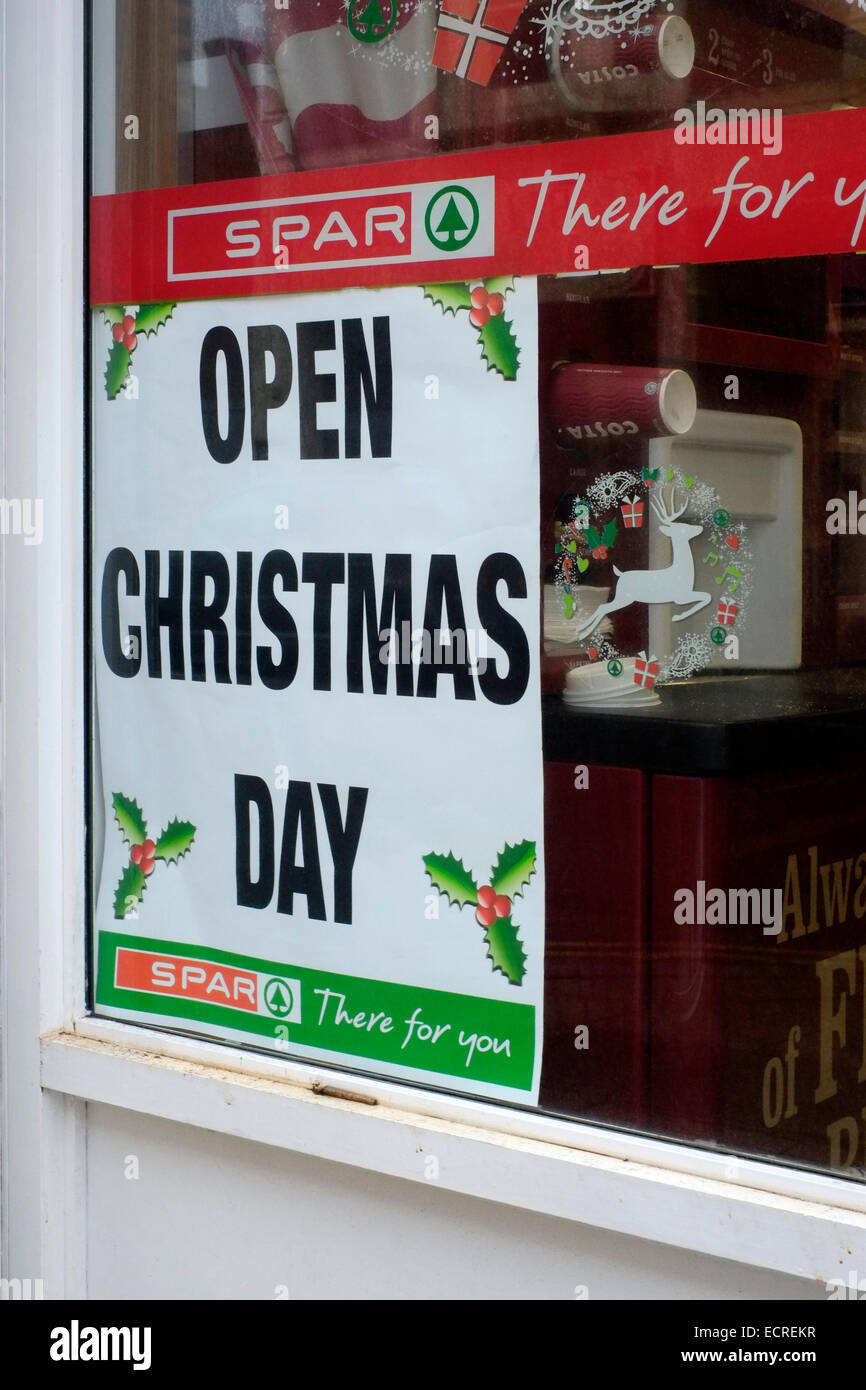 poster in a shop window advising customers that they are open on christmas day - Stock Image