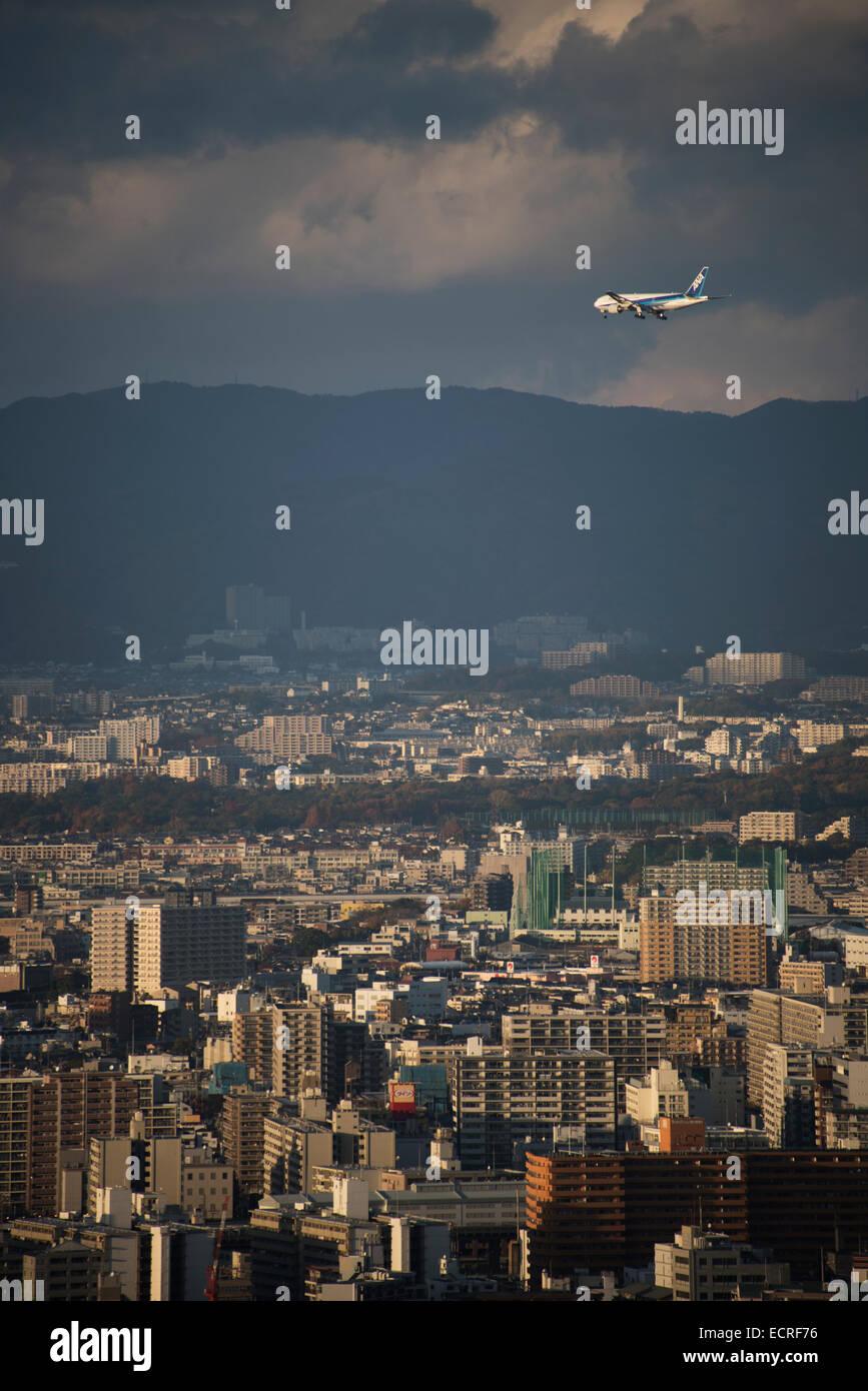 Civil aircraft landing at Kansai Airport, Osaka, Japan. - Stock Image