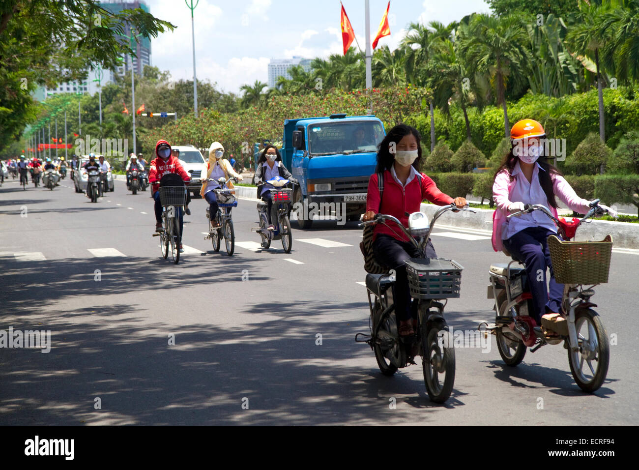 Scooter traffic on a street in Nha Trang, Vietnam. - Stock Image