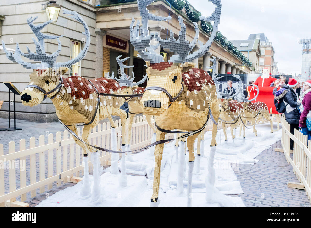 A full-size Santa's sleigh and reindeer made from 700,000 Lego bricks, Covent Garden, London, UK - Stock Image
