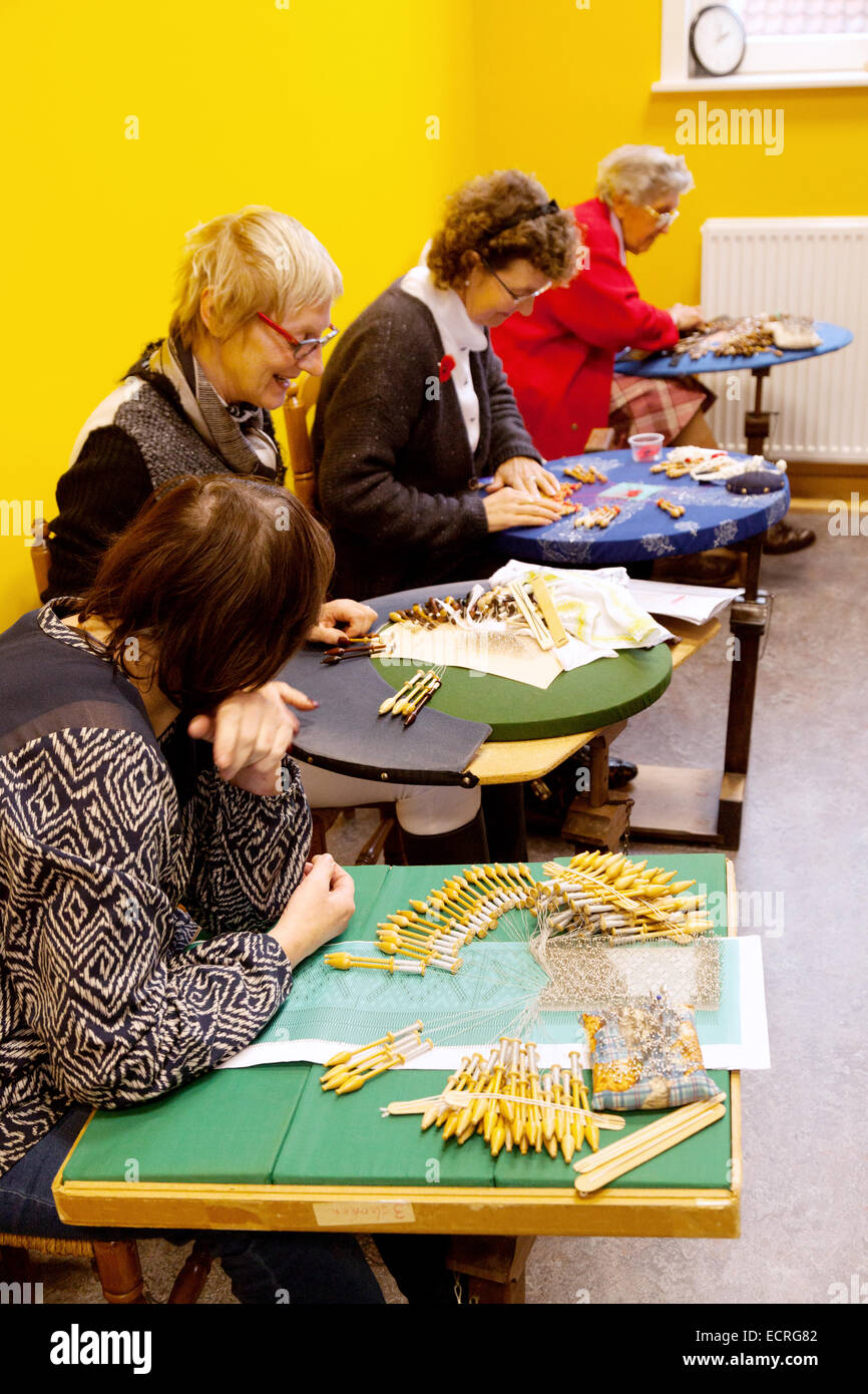 Four women making bobbin lace, the Lace Museum demonstration, Bruges Belgium, Europe - Stock Image