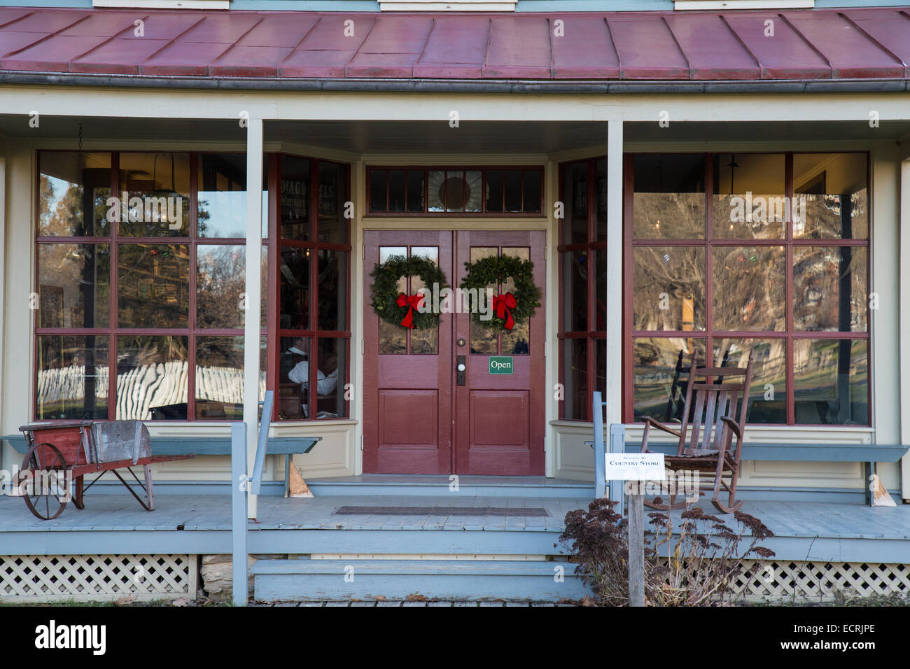 Country Store Front Decorated With Christmas Wreaths Stock Photo