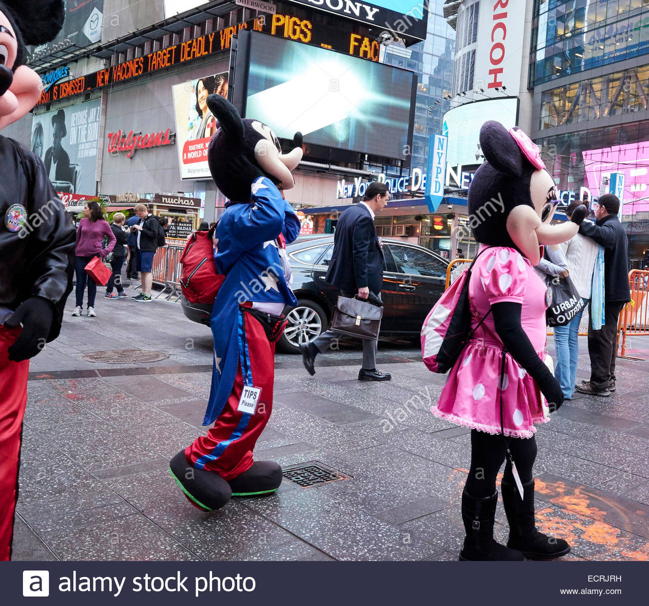 performers dressed up as cartoon characters who pose for photographs
