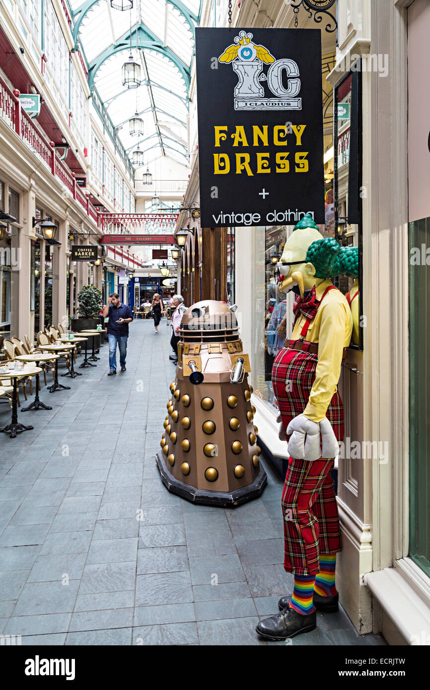 Sign for fancy dress shop with clown and dalek, Cardiff, Wales, UK - Stock Image