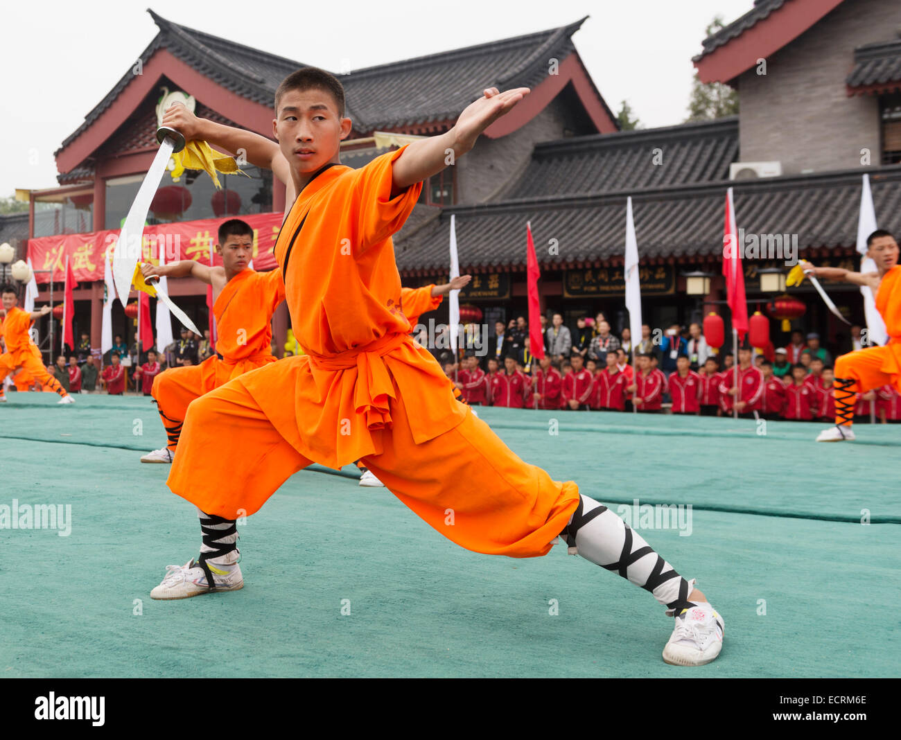 Shaolin Kung Fu student with a broad sword performing at the opening