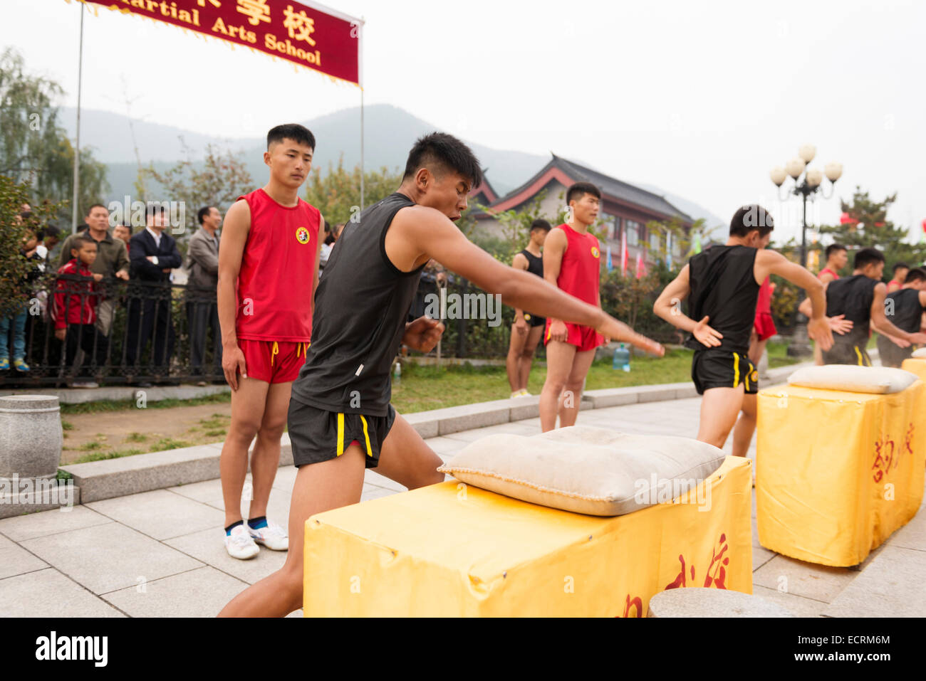 Students of Tagou Shaolin martial arts school conditioning their hands at the opening ceremony of Zhengzhou International - Stock Image