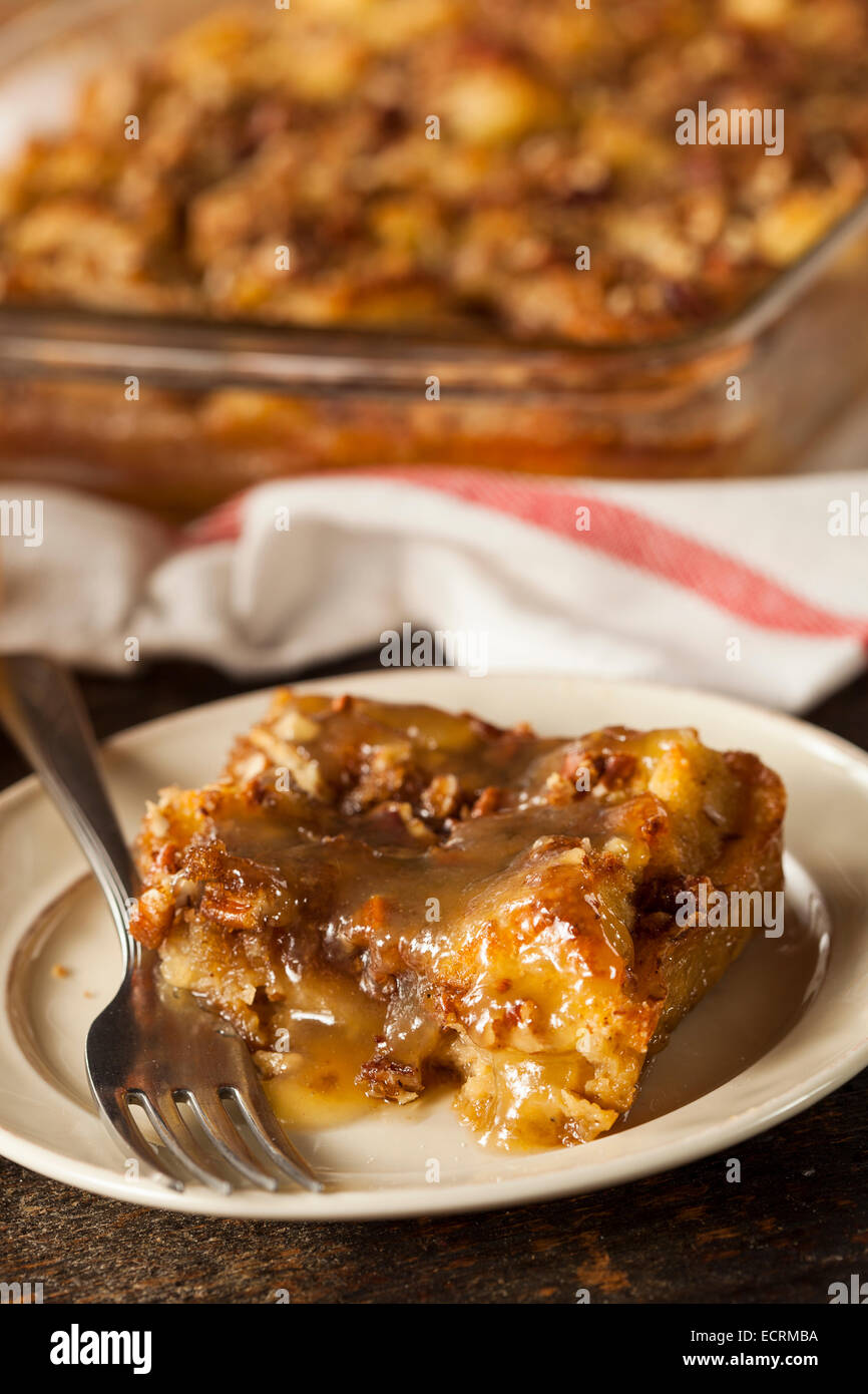 Sweet Homemade Bread Pudding Dessert with Brandy Sauce - Stock Image