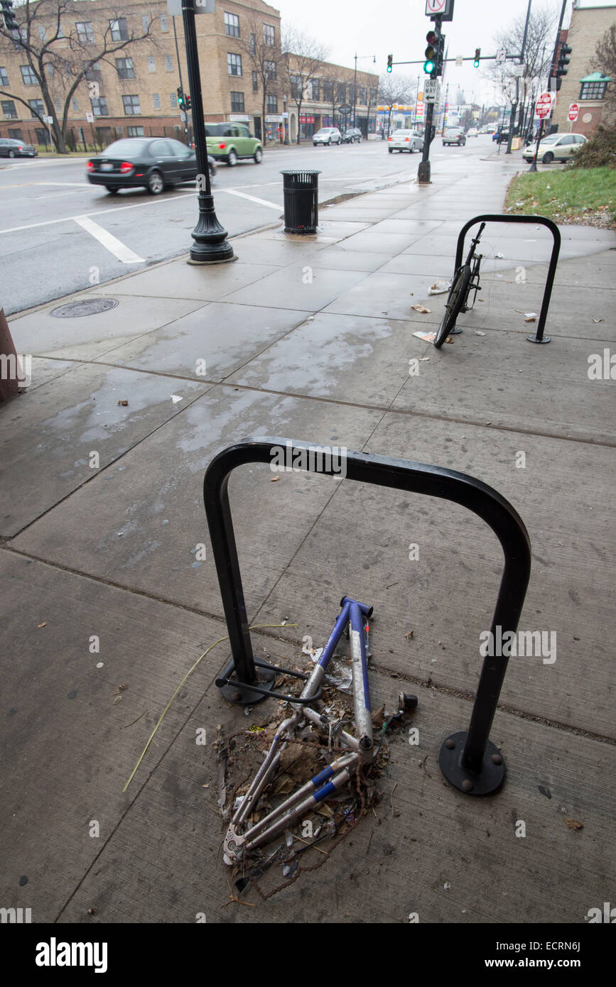 Frame from a vandalized bicycle locked to a bike rack, Chicago. - Stock Image