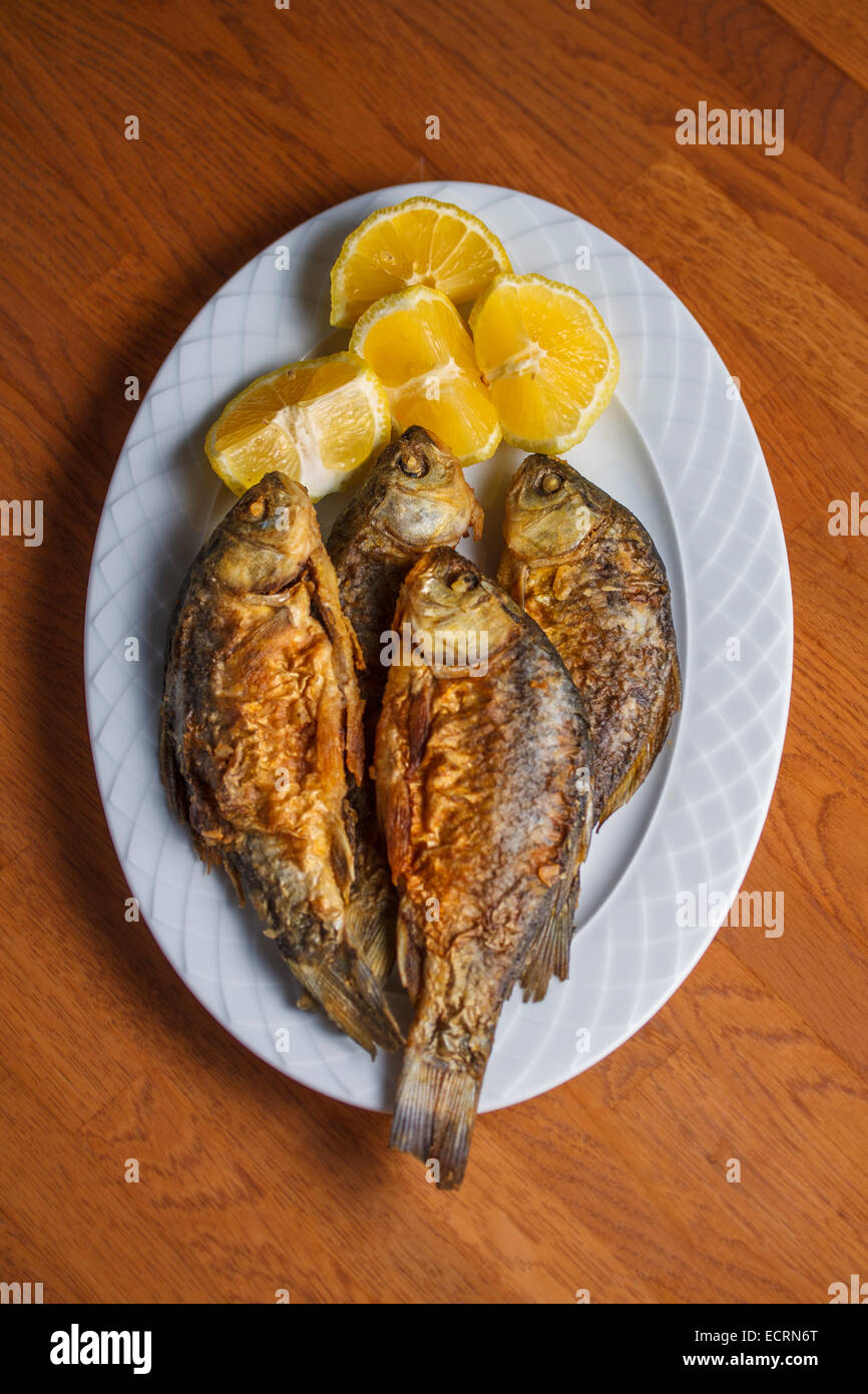 A traditional Greek food dish with Red snapper and lemons. Peloponnese, Greece Stock Photo