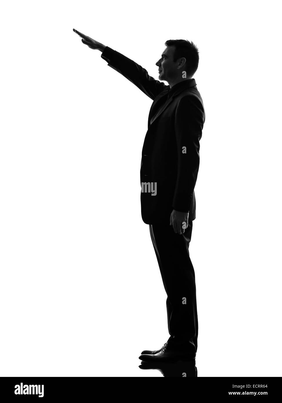 one caucasian extreme right wing man saluting in silhouette on white background - Stock Image