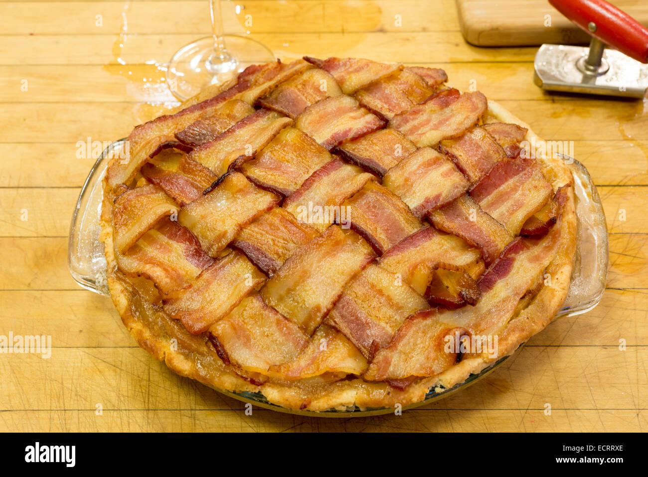 Bacon topped apple pie. Stock Photo