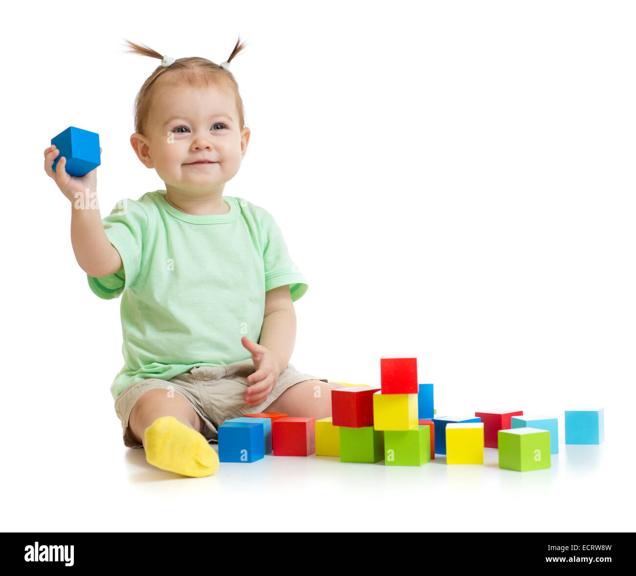 baby playing with colorful building blocks isolated on white - Stock Image