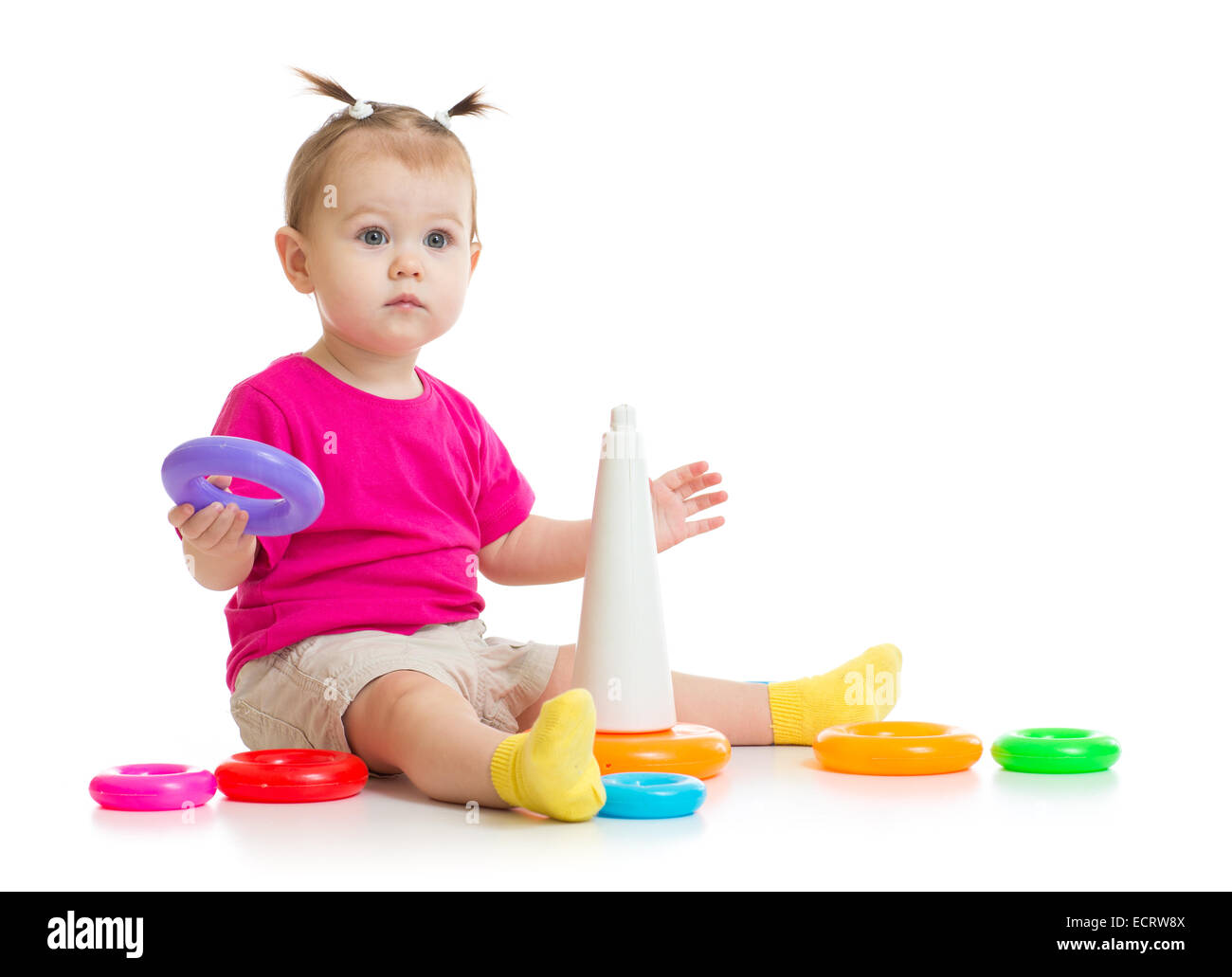 baby playing with colorful pyramid isolated on white - Stock Image