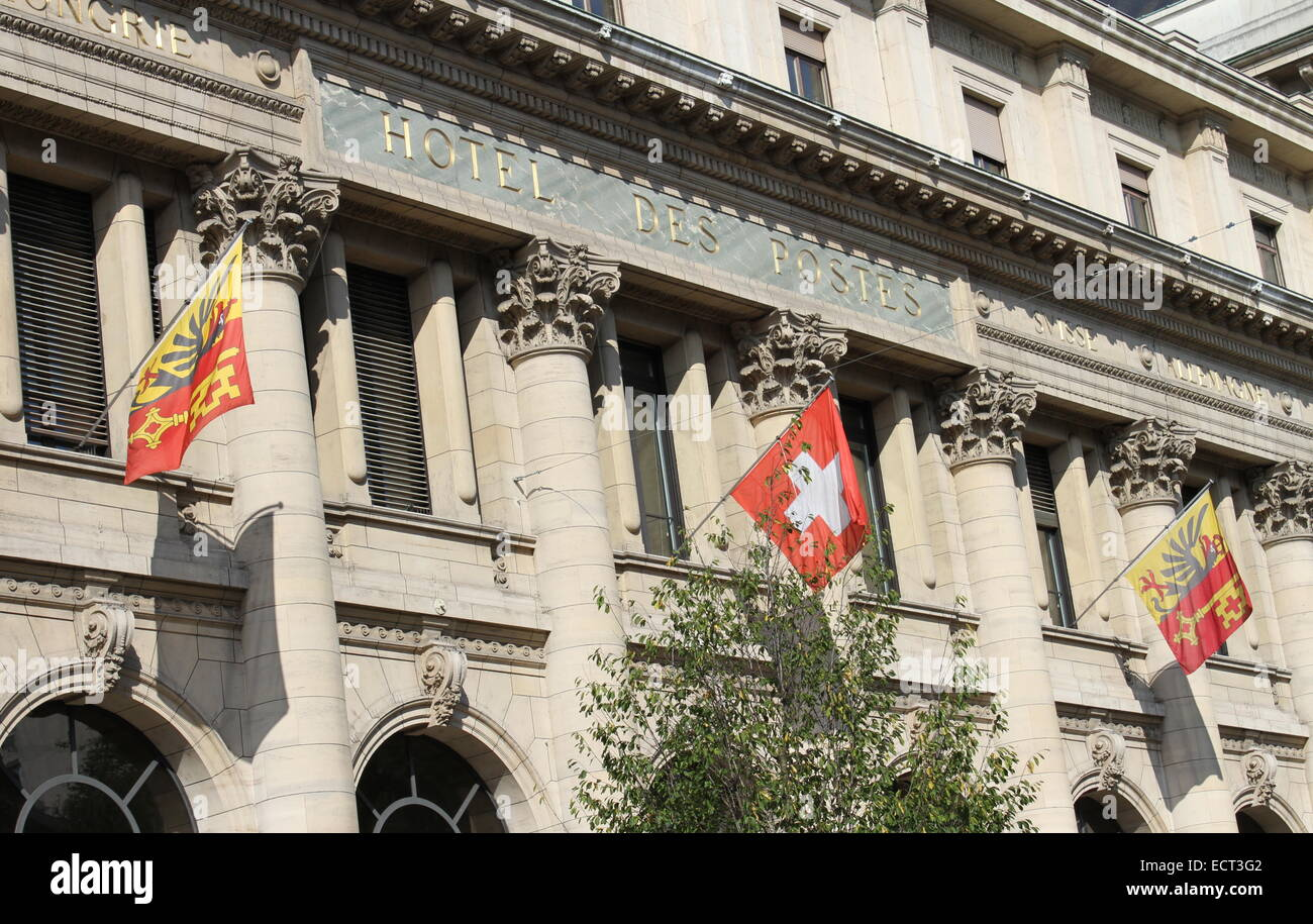 Close up on old post office building with Geneva and swiss flags, Switzerland - Stock Image