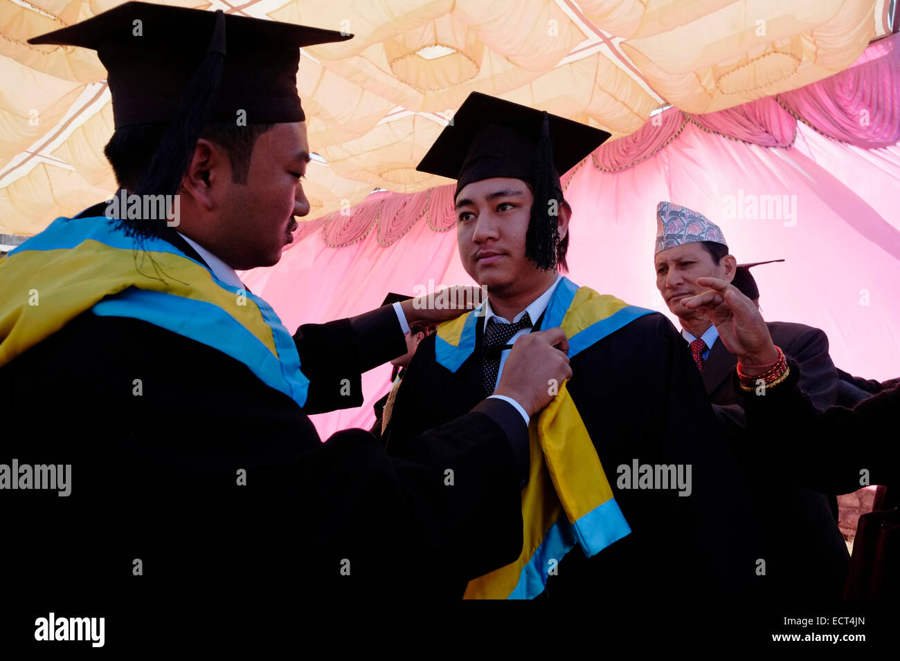 University students wearing a cap and gown preparing for the ...