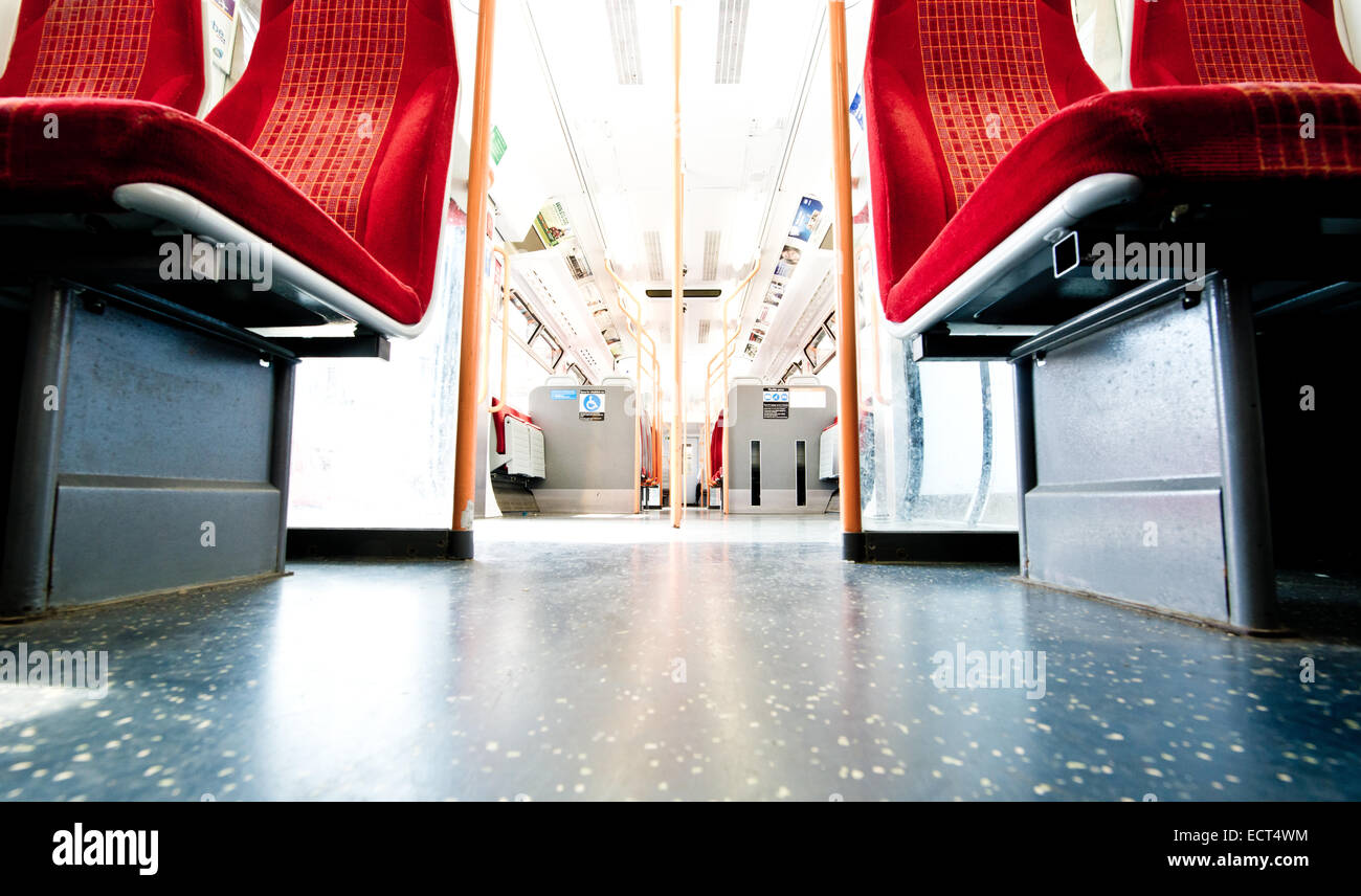 SW trains London orange seats, low angle - Stock Image