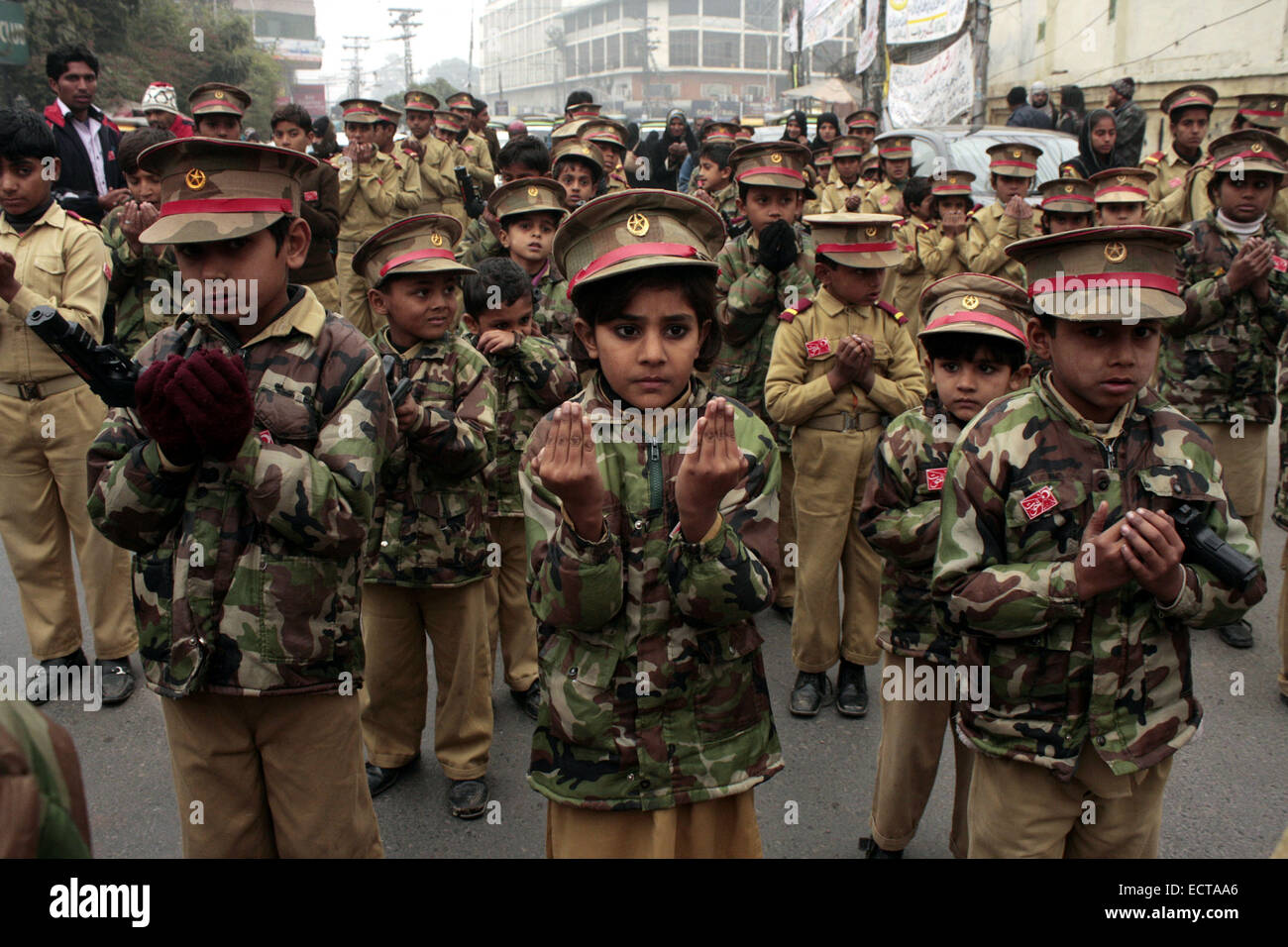 Lahore. 19th Dec, 2014. Pakistani children in army uniform attend a protest against the attack on an army-run school, - Stock Image