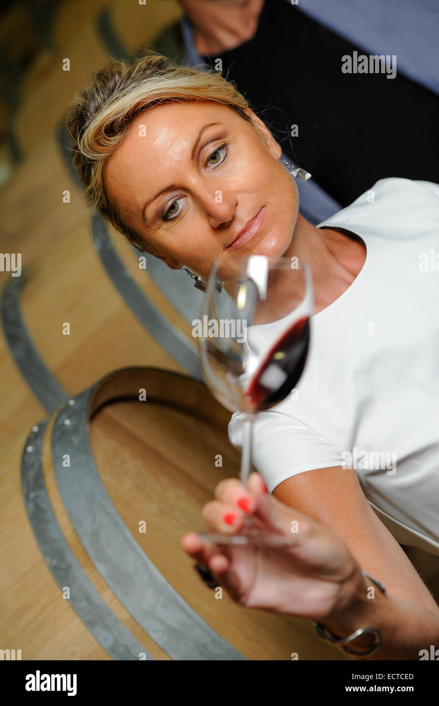Tourism - women tasting wine in a cellar-Winemaker - Stock Image