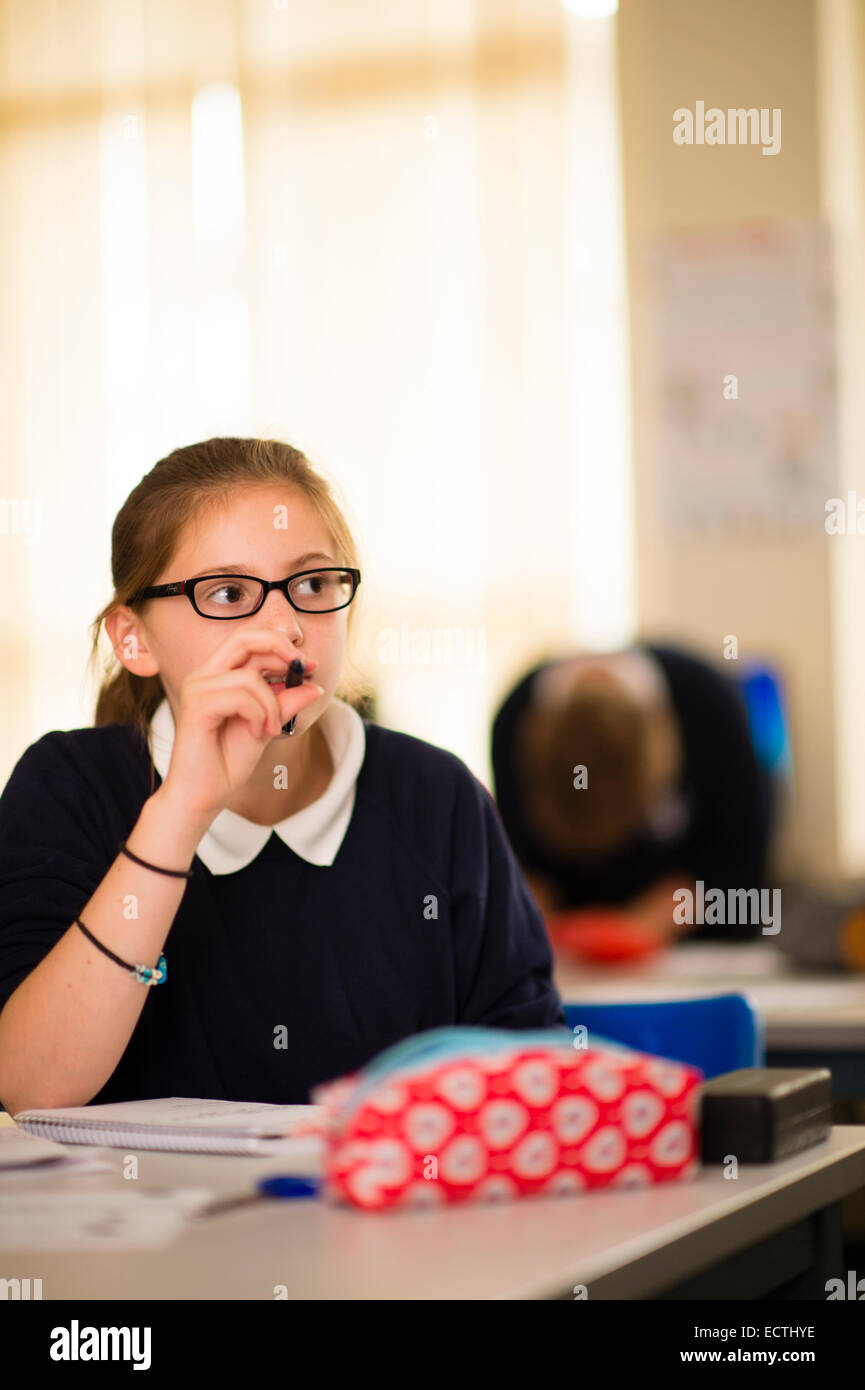 Secondary school education Wales UK: a young teenage schoolgirl in a classroom - Stock Image