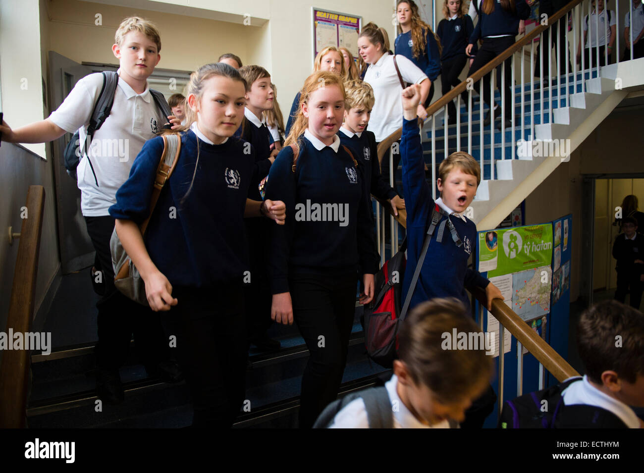 Secondary school education Wales UK: pupils  in the school corridor walking about to leave the school at the end - Stock Image