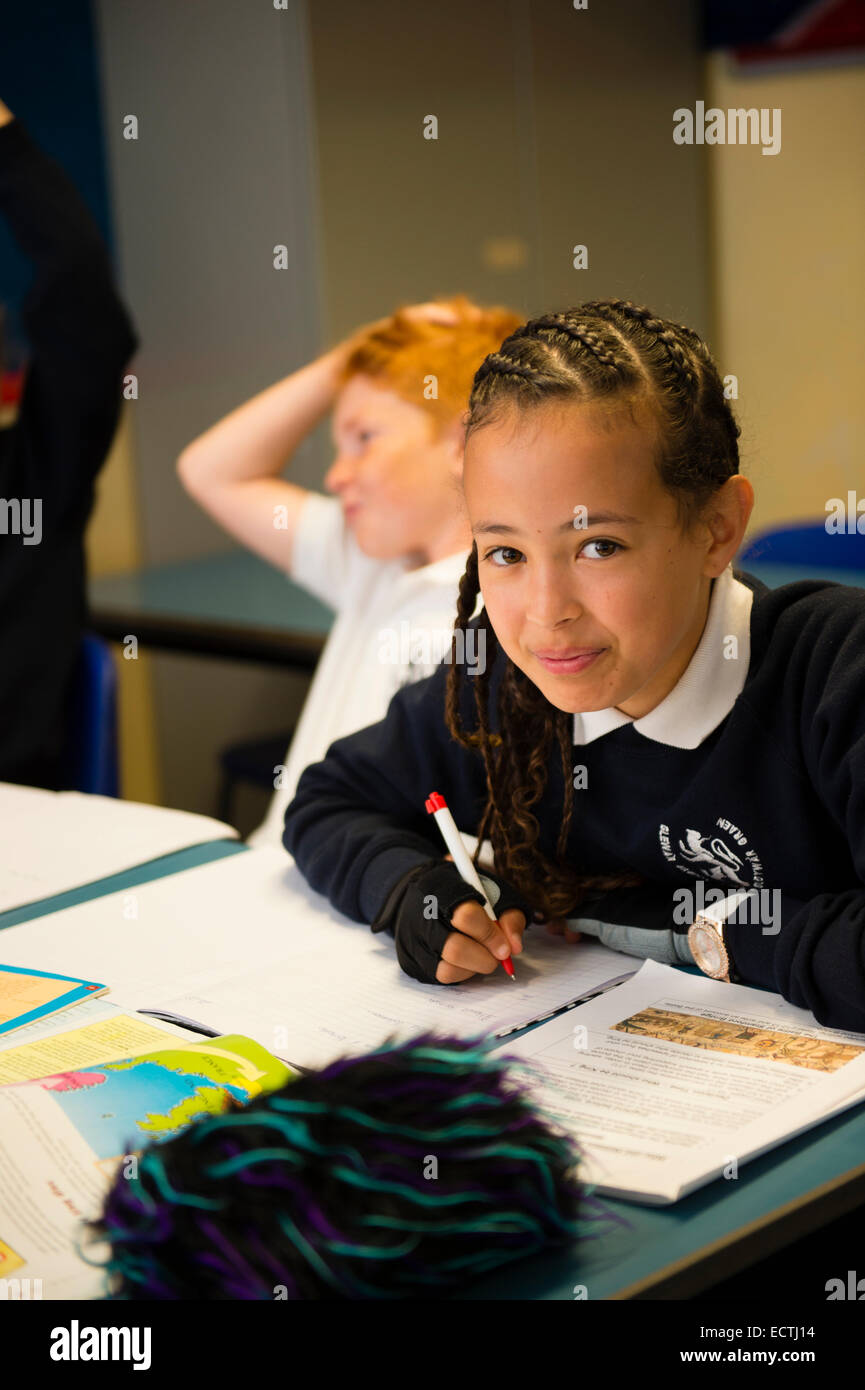 Secondary school education Wales UK: school children working in a classroom history class lesson - Stock Image