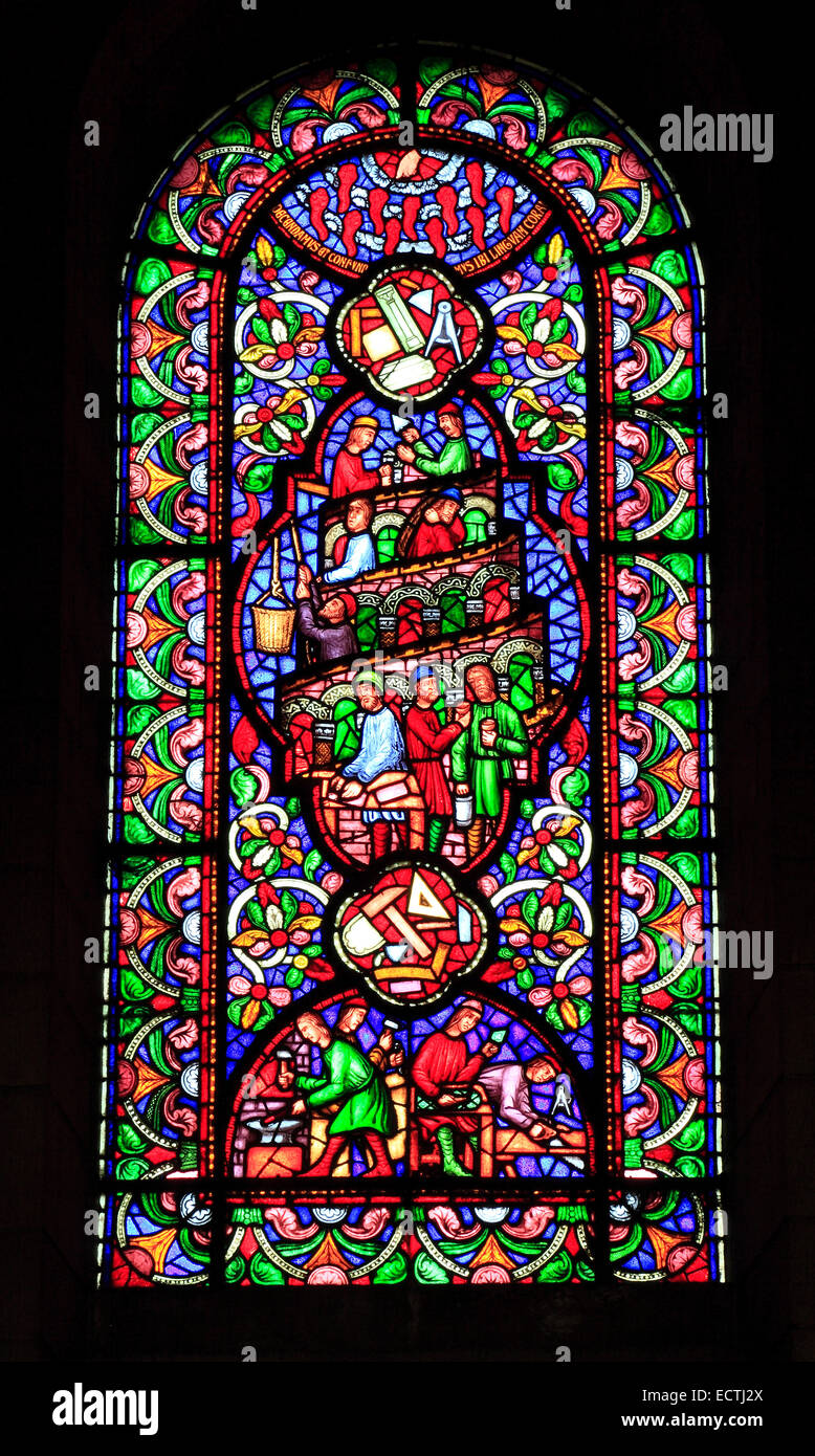 Stained Glass window, building the Tower of Babel by various craftsmen, Ely Cathedral, by Howes, Old Testament Bible - Stock Image