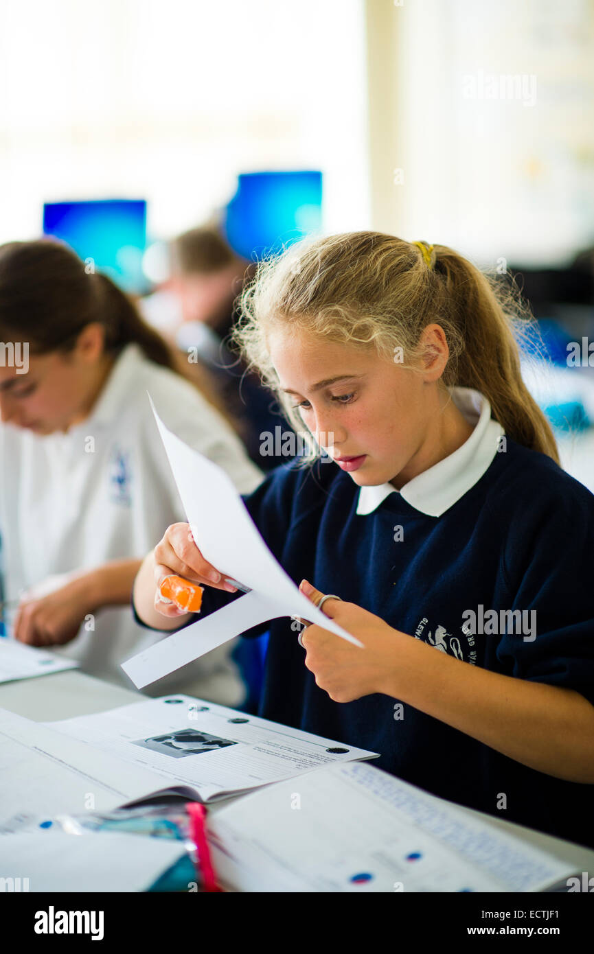 Secondary school education Wales UK: a young teenage girl in a classroom - Stock Image