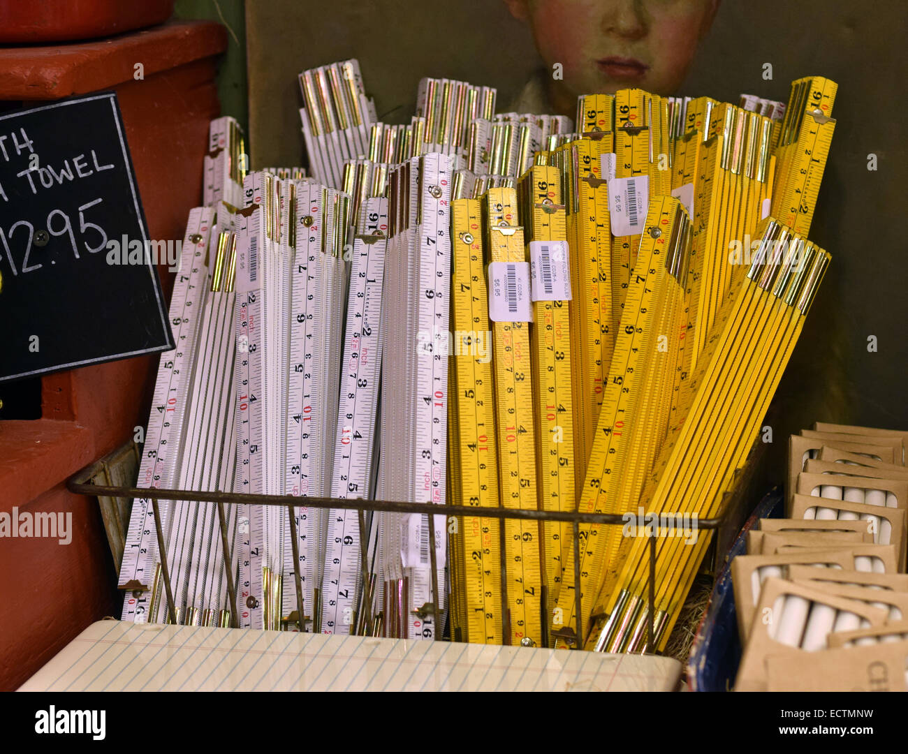 A basket of old fashioned wooden folding rulers on display at the Fish's Eddy on Broadway in lower Manhattan, - Stock Image