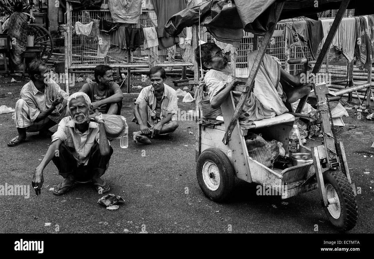 Beggars seek alms near the Hindu temple on August 17, 2011 in Kalighat, Kolkata, India. - Stock Image