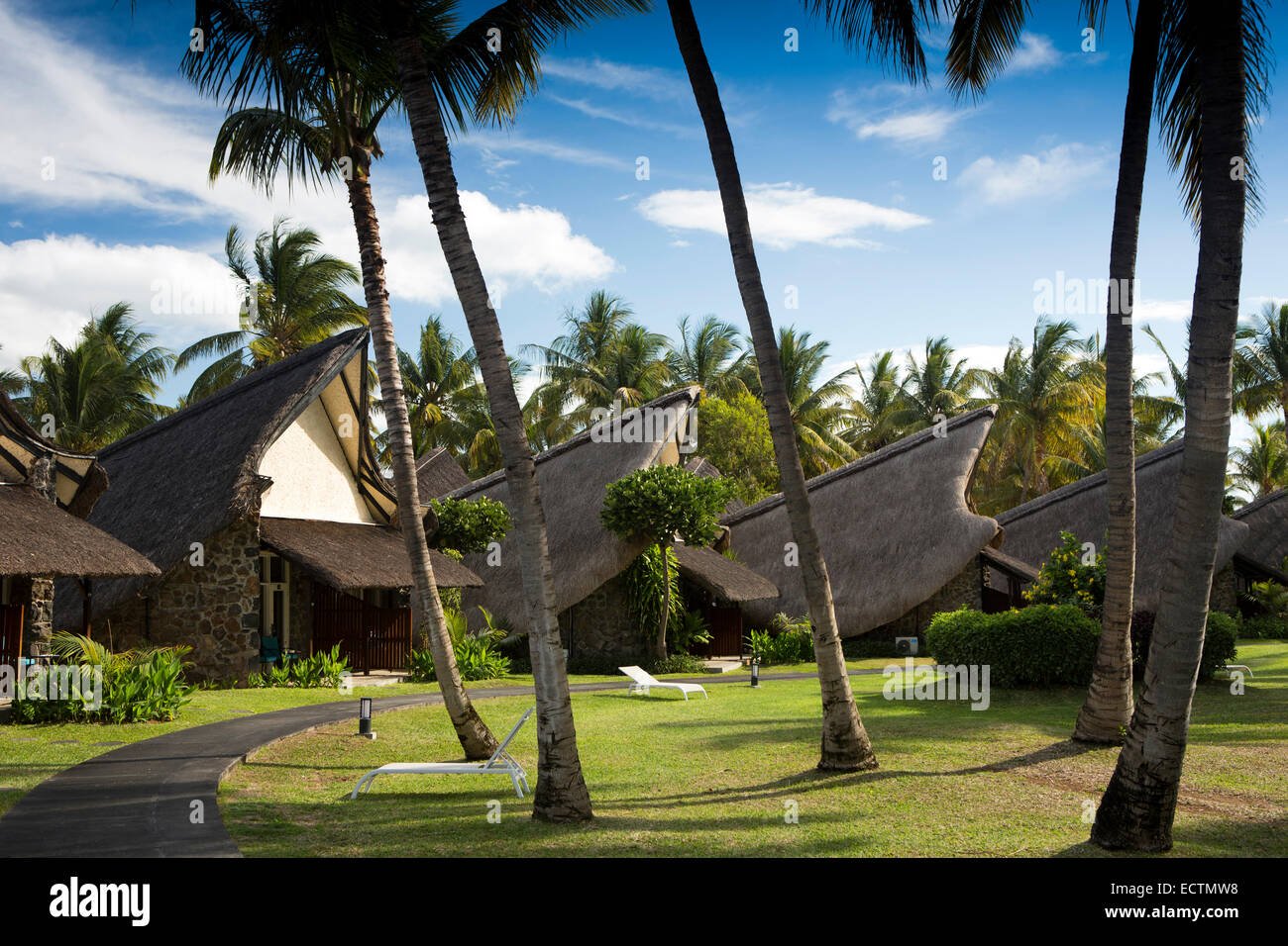 Mauritius, Flic en Flac, La Pirogue Hotel, thatched, boat shaped rooms in tropical garden Stock Photo