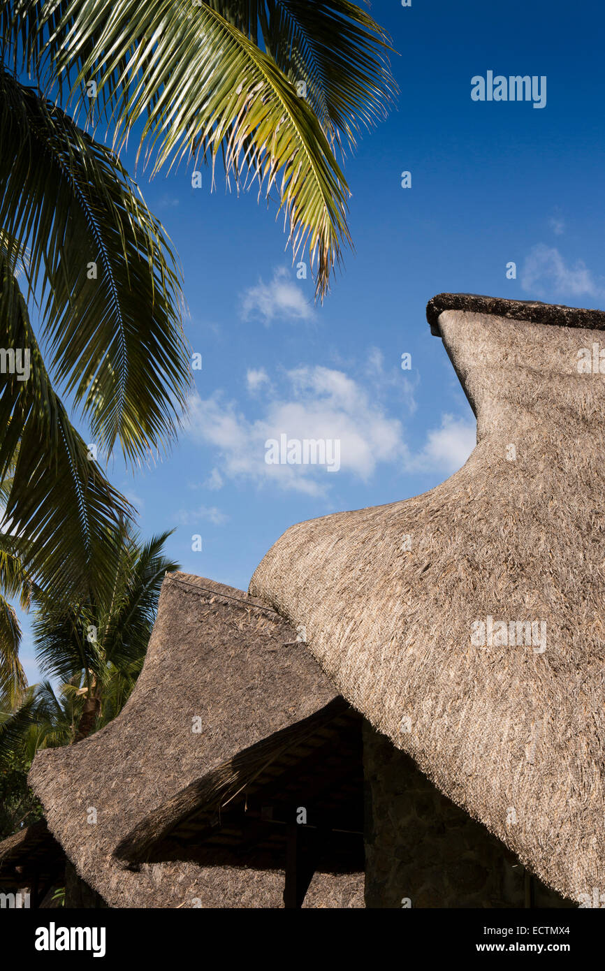 Mauritius, Flic en Flac, La Pirogue Hotel, thatched, boat shaped rooms in tropical garden - Stock Image