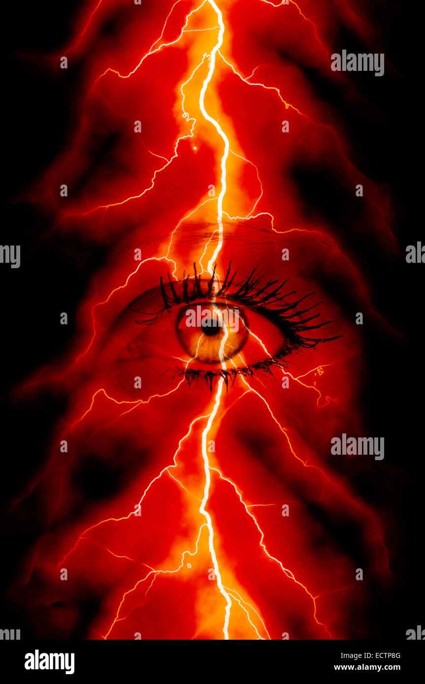 creative composite of an eye of a woman and lightning - Stock Image