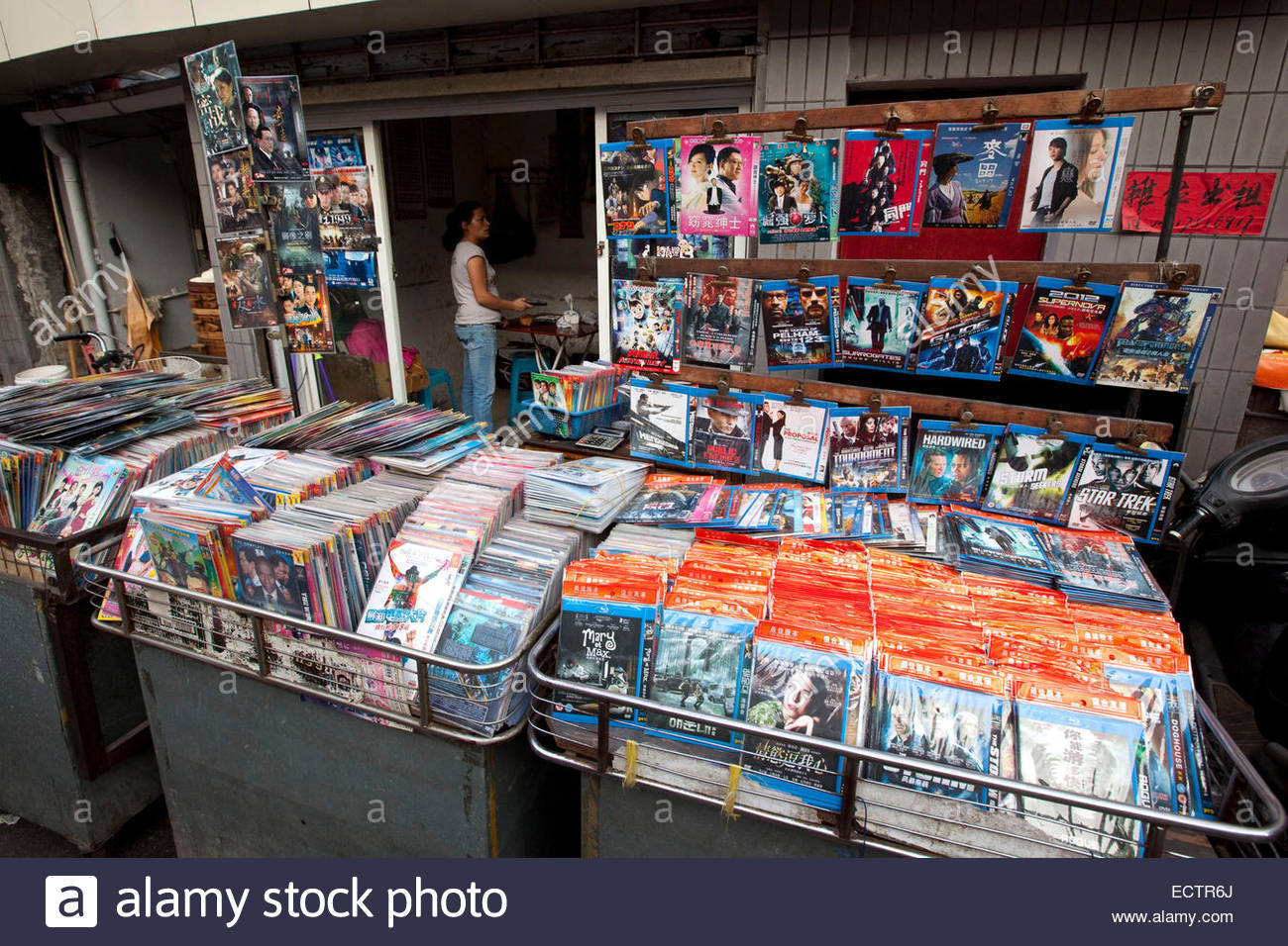 Shanghai, DVD copies for sale on market. - Stock Image