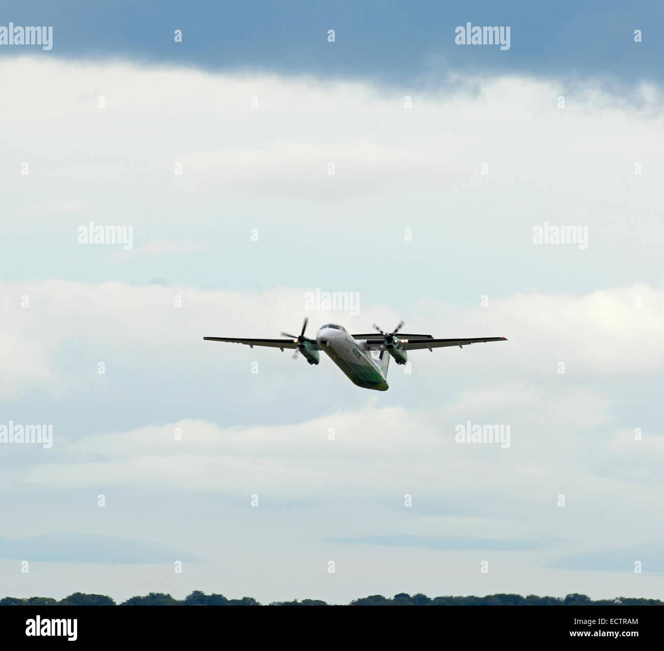 Departing Widerøe flight back to Norway from Aberdeen Dyce is this Dash 8 Bombardier DHC-8-311Q.  SCO 9374 - Stock Image