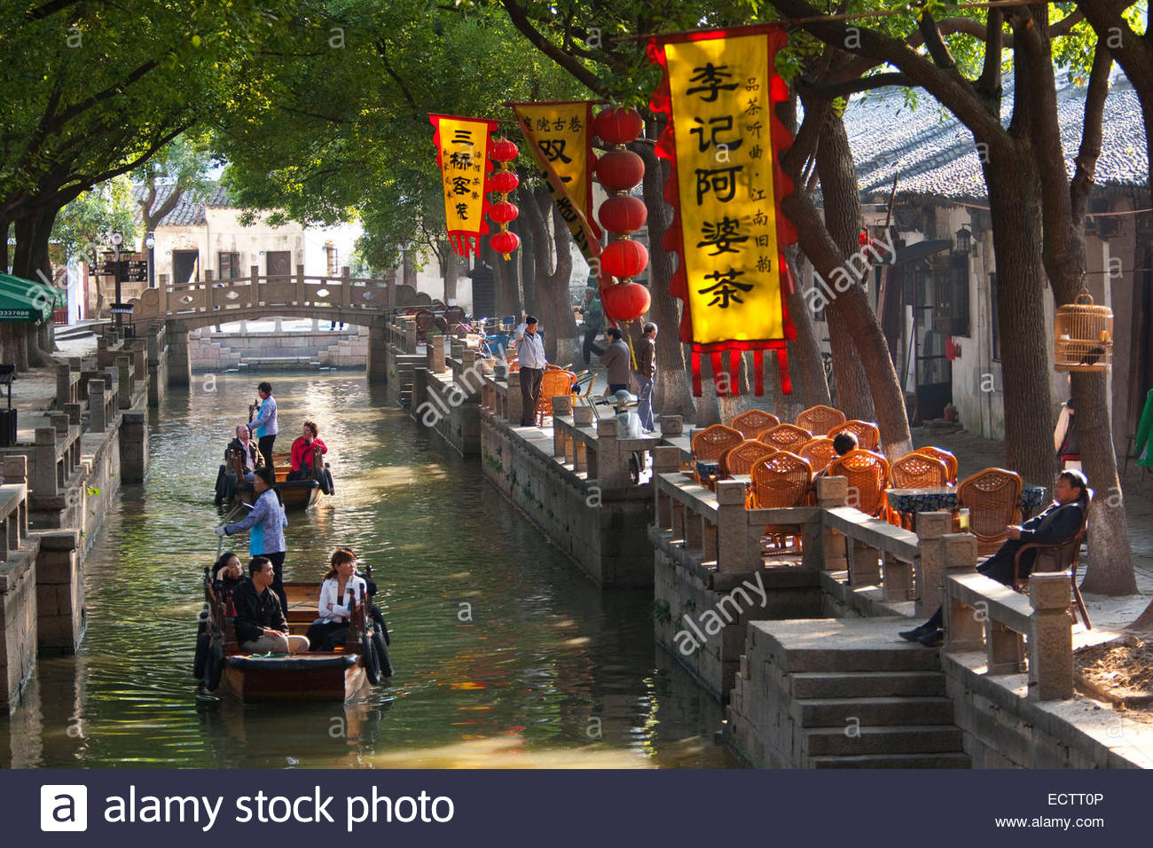 Shanghai, Tourists travelling on the canals of Tongli. - Stock Image