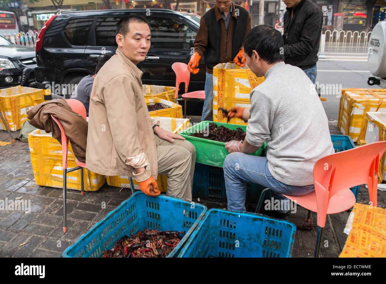 Men preparing crayfish, Ghost Street - Stock Image