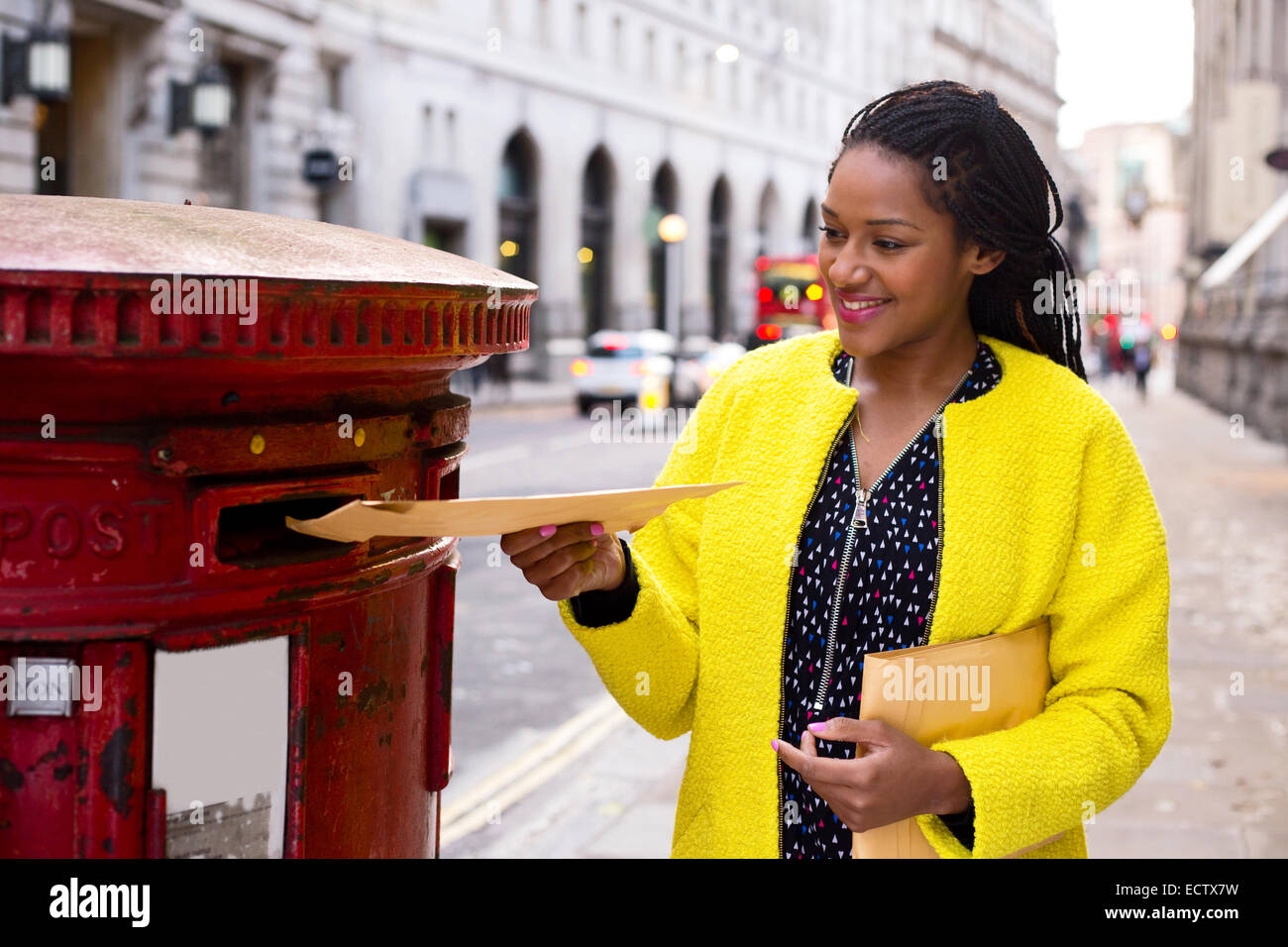 young woman posting letters. - Stock Image