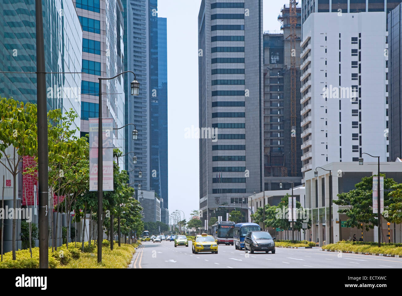 Traffic and high-rise office blocks and skyscrapers in the Central Area / Central Business District of Singapore - Stock Image