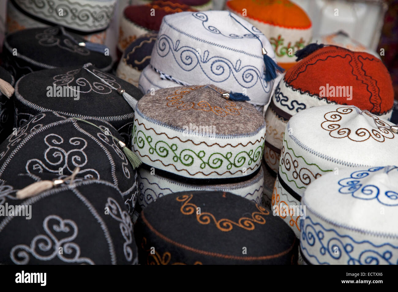 Traditional tubeteikas, male Kyrgyz caps for sale at market in Osh, Kyrgyzstan - Stock Image