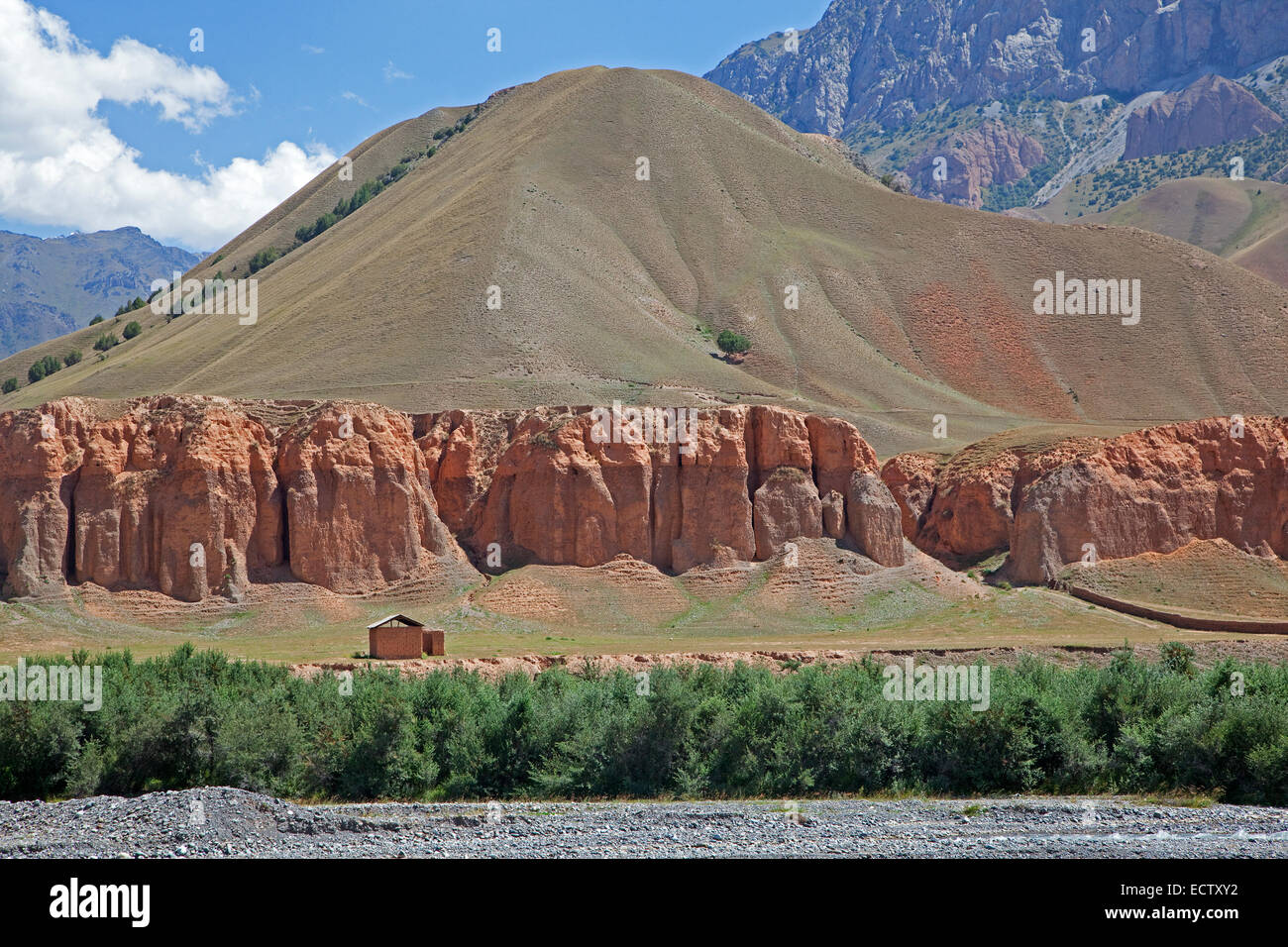 Red sandstone formations in the mountains of the Osh Province, Kyrgyzstan - Stock Image