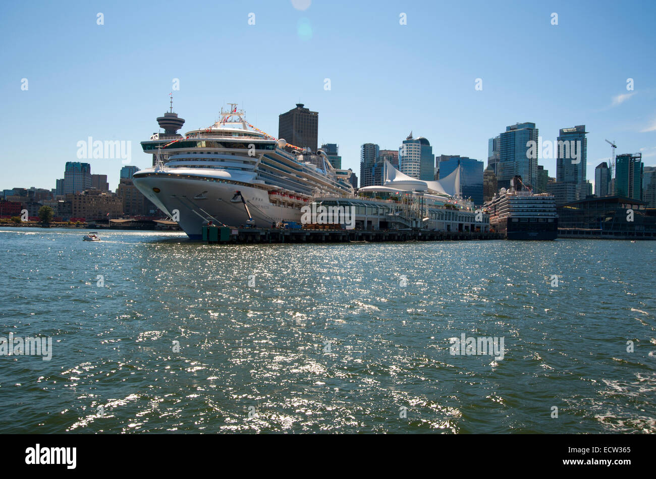Canada Place and cruise ships with skyscrapers in background, Vancouver, British Columbia, Canada - Stock Image